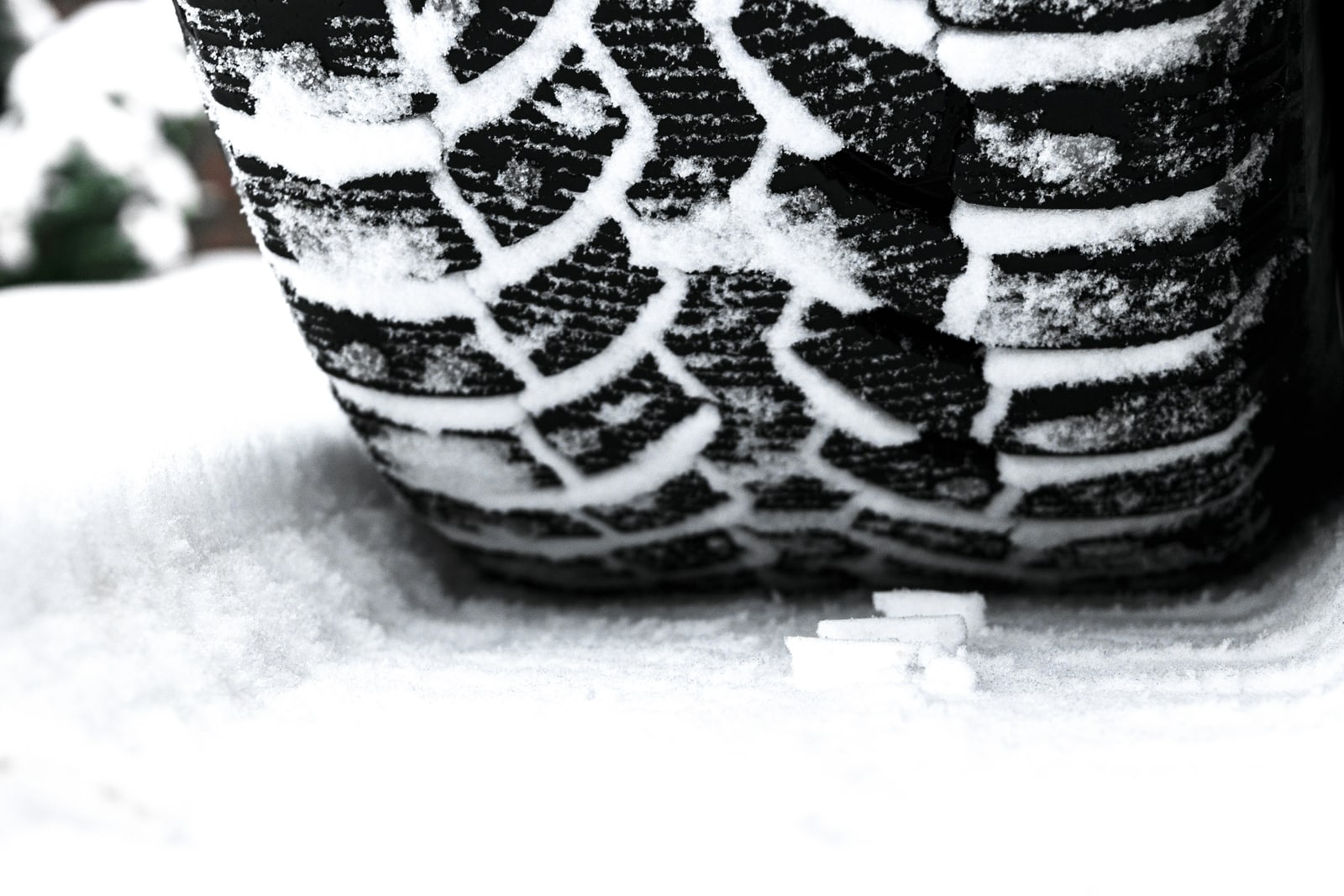 bigstock-The-Car-Tire-In-The-Snow-Close-274716940